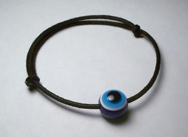 Evil Eye adjustable bracelet on black cord